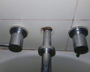 Gaps behind bath spout